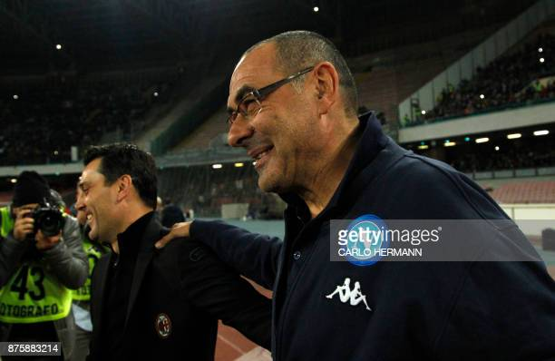 Napoli's coach Maurizo Sarri greets AC Milan's coach Vincenzo Montella before the Italian Serie A football match SSC Napoli vs AC Milan on November...