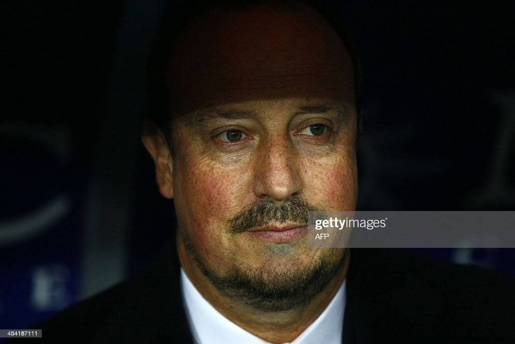 SSC Napoli's coach Rafa Benitez follows during the Italian Serie A football match SSC Napoli vs Udinese at the San Paolo Stadium in Naples on December 7, 2013.