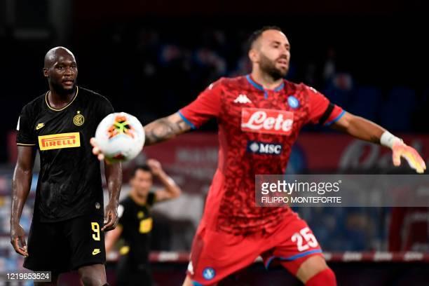 Napoli's Colombian goalkeeper David Ospina clears a ball as Inter Milan's Belgian forward Romelu Lukaku looks on during the Italian Cup semi-final...