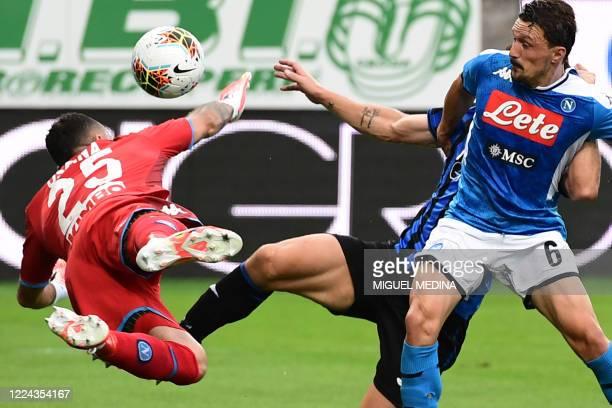 Napoli's Colombian goalkeeper David Ospina collides with Atalanta's Italian defender Mattia Caldara as Napoli's Portuguese defender Mario Rui looks...