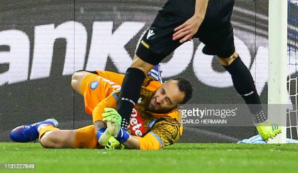 Napoli's Colombian goalkeeper David Ospina collides with Udinese's Argentine forward Ignacio Pussetto during the Italian Serie A football match...