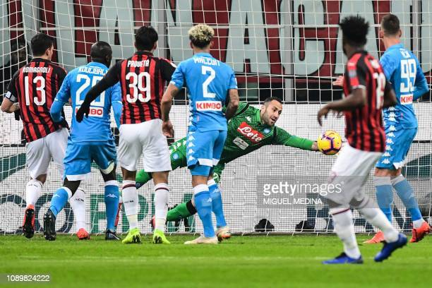 Napoli's Colombian goalkeeper David Ospina deflects a shot during the Italian Serie A football match AC Milan vs Napoli on January 26 2019 at the San...