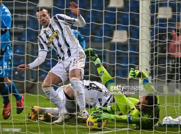 Napoli's Colombian goalkeeper David Ospina saves on the line a shot from Juventus' Italian forward Federico Bernardeschi during the Italian Super Cup...