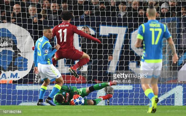 Napoli's Colombian goalkeeper David Ospina saves s shot from Liverpool's Egyptian midfielder Mohamed Salah during the UEFA Champions League group C...