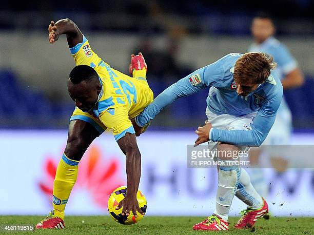 Napoli's Colombian midfielder Pablo Estifer Armero vies for the ball with Lazio's Argentinian midfielder Lucas Biglia during the Serie A football...