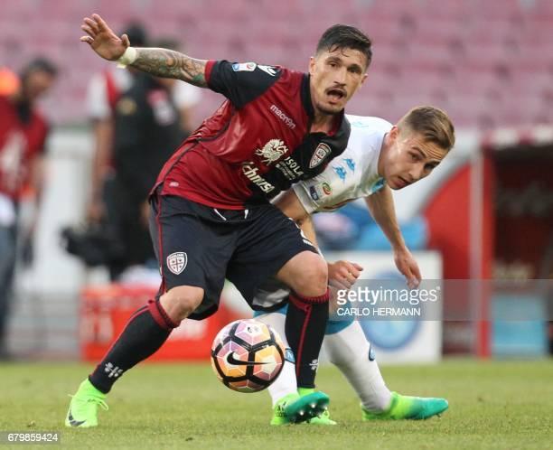 Napoli's Croatian midfielder Marko Rog fights for the ball with Cagliari's Italian defender Fabio Pisacane during the Italian Serie A football match...