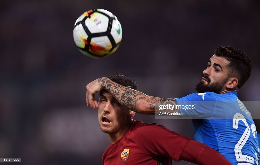 Napoli's defender from Albania Elseid Hysaj (R) vies with Roma's midfielder Lorenzo Pellegrini during the Italian Serie A football match Roma vs Napoli at the Olympic Stadium in Rome on October 14, 2017. /
