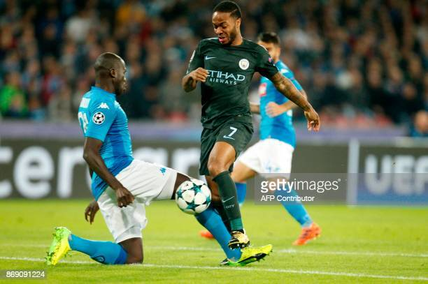 Napoli's defender from France Kalidou Koulibaly vies with Manchester City's English midfielder Raheem Sterling during the UEFA Champions League...