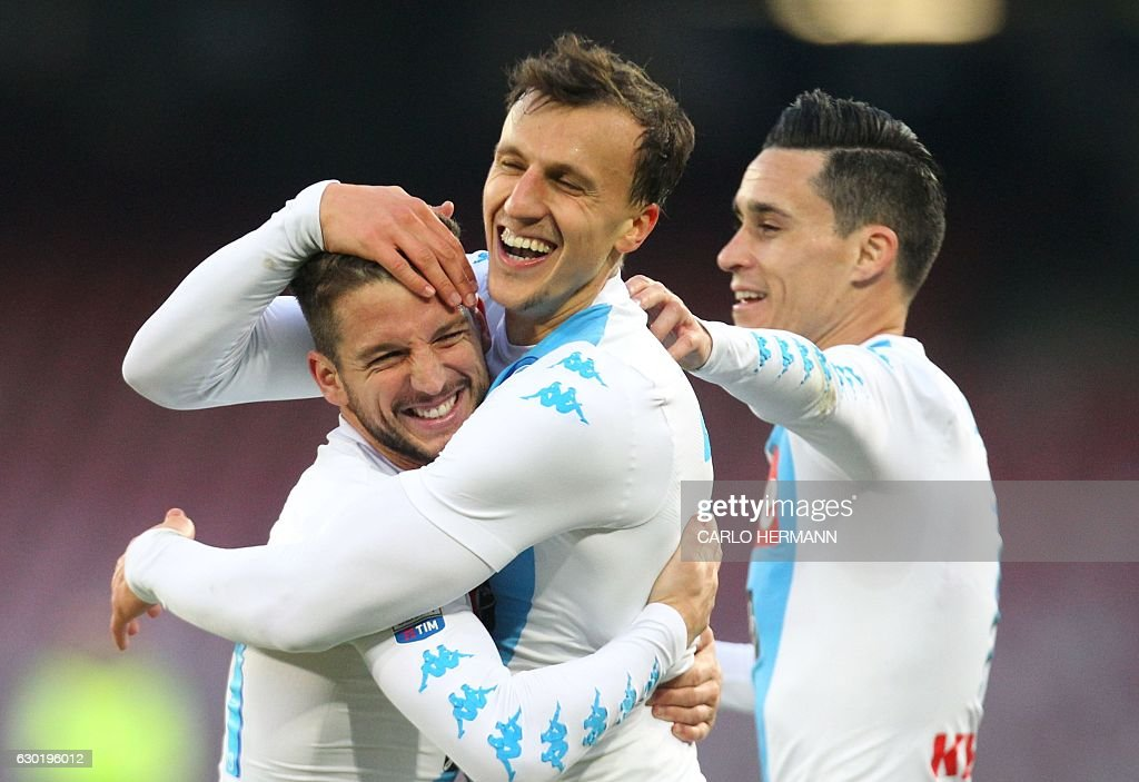 Napoli's defender from Romania Vlad Chiriches (C) celebrates after scoring with teammate Napoli's forward from Belgium Dries Mertens (L) and Napoli's forward from Spain Jose Maria Callejon during the Italian Serie A football match SSC Napoli vs Torino FC on December 18, 2016 at the San Paolo Stadium in Naples. / AFP / CARLO