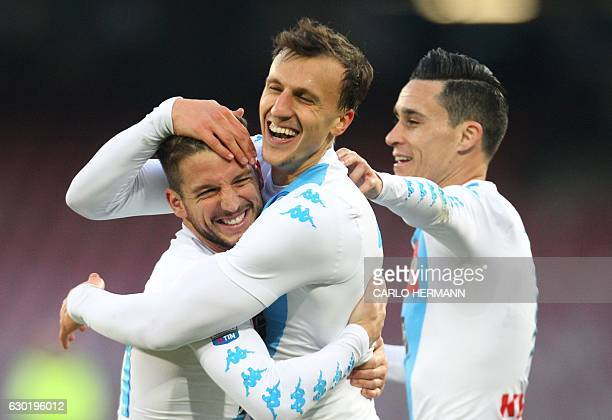 Napoli's defender from Romania Vlad Chiriches celebrates after scoring with teammate Napoli's forward from Belgium Dries Mertens and Napoli's forward...