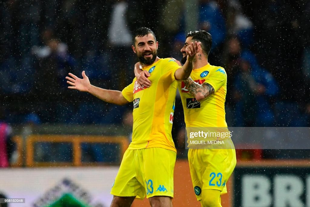 Napoli's defender from Spain Raul Albiol (L) celebrates with teammate Napoli's defender from Albania Elseid Hysaj after scoring during the Italian Serie A football match Sampdoria vs Napoli on May 13, 2018 at the Luigi Ferraris stadium in Genova. (Photo by Miguel MEDINA / AFP) / The erroneous mention[s] appearing in the metadata of this photo by Miguel MEDINA has been modified in AFP systems in the following manner: [May 13] instead of [April 13]. Please immediately remove the erroneous mention[s] from all your online services and delete it (them) from your servers. If you have been authorized by AFP to distribute it (them) to third parties, please ensure that the same actions are carried out by them. Failure to promptly comply with these instructions will entail liability on your part for any continued or post notification usage. Therefore we thank you very much for all your attention and prompt action. We are sorry for the inconvenience this notification may cause and remain at your disposal for any further information you may require.