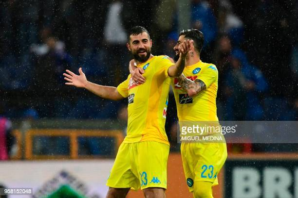 Napoli's defender from Spain Raul Albiol celebrates with teammate Napoli's defender from Albania Elseid Hysaj after scoring during the Italian Serie...