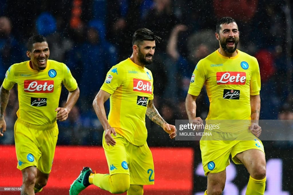 Napoli's defender from Spain Raul Albiol (R) celebrates with teammate Napoli's defender from Albania Elseid Hysaj (C) after scoring during the Italian Serie A football match Sampdoria vs Napoli on May 13, 2018 at the Luigi Ferraris stadium in Genova. (Photo by Miguel MEDINA / AFP) / The erroneous mention[s] appearing in the metadata of this photo by Miguel MEDINA has been modified in AFP systems in the following manner: [May 13] instead of [April 13]. Please immediately remove the erroneous mention[s] from all your online services and delete it (them) from your servers. If you have been authorized by AFP to distribute it (them) to third parties, please ensure that the same actions are carried out by them. Failure to promptly comply with these instructions will entail liability on your part for any continued or post notification usage. Therefore we thank you very much for all your attention and prompt action. We are sorry for the inconvenience this notification may cause and remain at your disposal for any further information you may require.