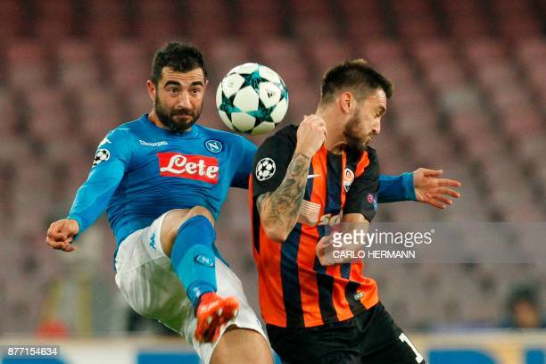 Napoli's defender from Spain Raul Albiol fights for the ball with Shakhtar Donetsk's Argentinian forward Facundo Ferreyra during the UEFA Champions...