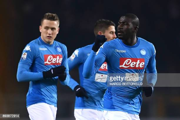 Napoli's defender Kalidou Koulibaly from France celebrates with teammates after scoring during the Italian Serie A football match Torino Vs Napoli on...