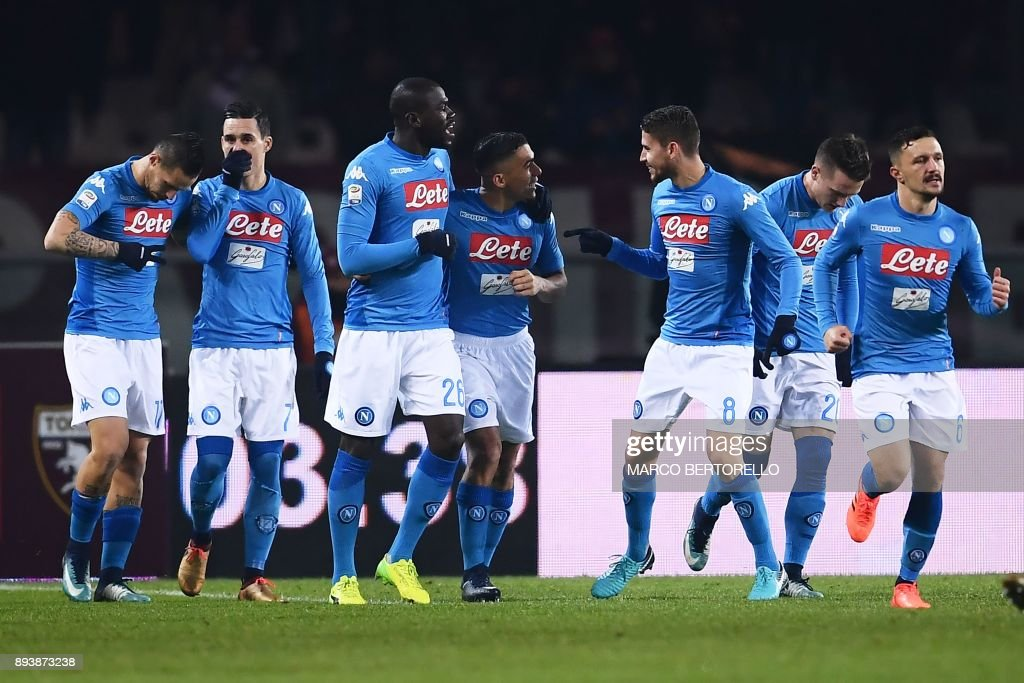 Napoli's defender Kalidou Koulibaly from France (3rdL) celebrates with teammates after scoring during the Italian Serie A football match Torino Vs Napoli on December 16, 2017 at the 'Grande Torino' stadium in Turin. /