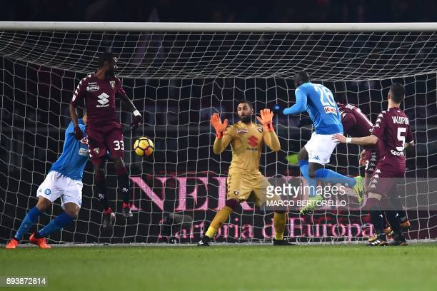 Napoli's defender Kalidou Koulibaly from France scores during the Italian Serie A football match Torino Vs Napoli on December 16 2017 at the 'Grande...