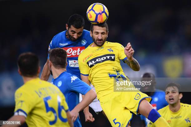 Napoli's defender Raul Albiol of Spain fights for the ball with Chievo's defender Alessandro Gamberini during the Italian Serie A football match...