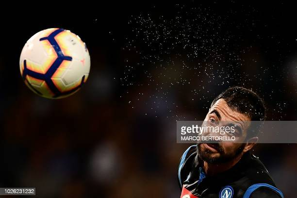 TOPSHOT Napoli's defender Raul Albiol of Spain heads the ball during the Italian Serie A football match Sampdoria vs Napoli on September 2 2018 at...