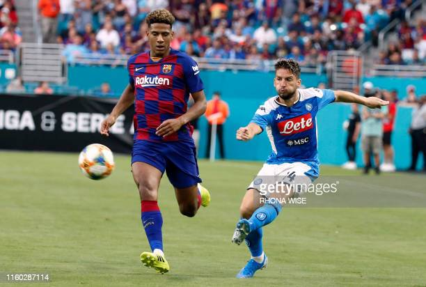 Napoli's Dries Mertens battles for the ball with Barcelona's Jean-Clair Todibo during the International Champions Cup football match between FC...