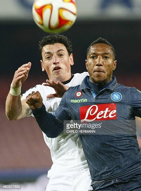 Napoli's Dutch forward Jonathan De Guzman fights for the ball with Slovan's Slovak defender David Hudak during the UEFA Europa League Group I...