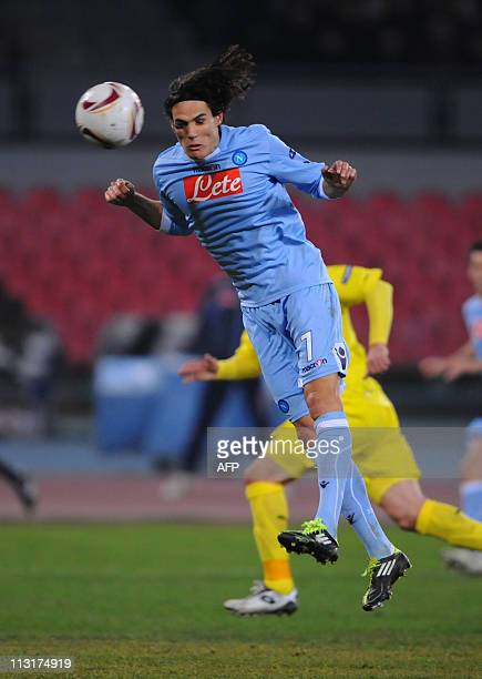 Napoli's Edinson Cavani heads the ball during the Europa League football match Napoli vs Villareal on February 17 2011 in Naples AFP Photo / CARLO...