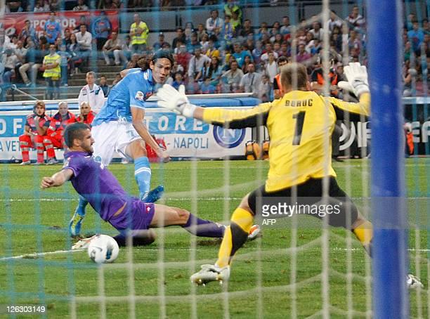 Napoli's Edinson Cavani vies for the ball with Fiorentina's Gamberini as Fiorentina's goalkeeper deviates the ball during the Italian Serie A footall...