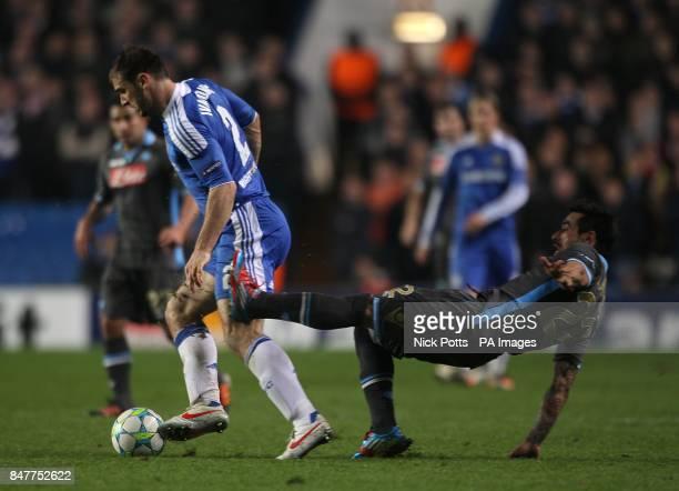 Napoli's Ezequiel Lavezzi and Chelsea's Branislav Ivanovic battle for the ball
