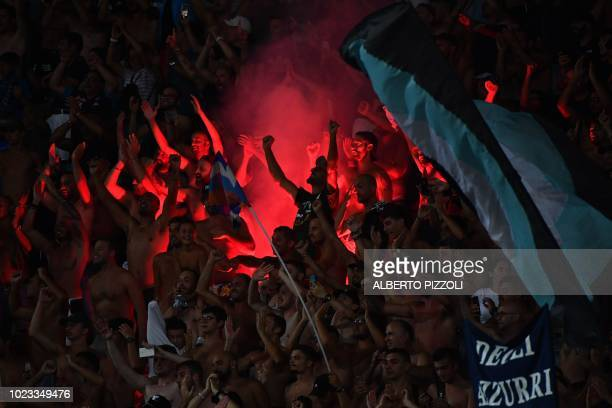 Napoli's fans celebrate after Napoli defeated AC Milan in their Italian Serie A football match on August 25 2018 at the San Paolo Stadium in Naples