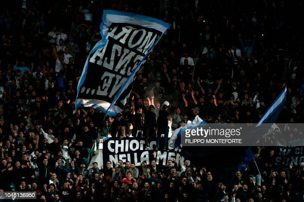 Napoli's fans cheer during the UEFA Champions League group C football match between Napoli and Liverpool on October 3 2018 at the San Paolo stadium...