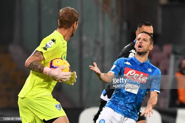 Napoli's forward Dries Mertens from Belgium argues with Empoli's Italian goalkeeper Ivan Provedel during the Italian Serie A football match Napoli vs...