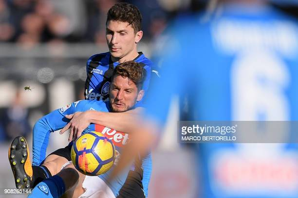 Napoli's forward Dries Mertens from Belgium fights for the ball with Atalanta's defender Mattia Caldara during the Italian Serie A football match...