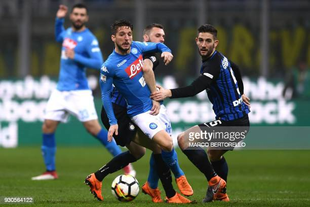 Napoli's forward Dries Mertens from Belgium fights for the ball with Inter Milan's midfielder Roberto Gagliardini from Italy during the Italian Serie...