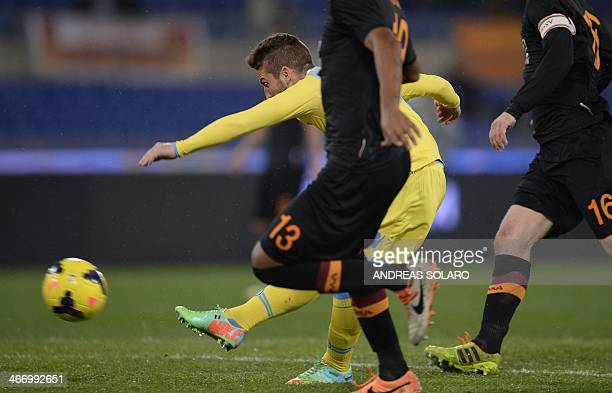 Napoli's forward Dries Mertens shoots and scores against AS Roma during their semi'final Coppa Italia football match on February 5 2014 at Rome's...