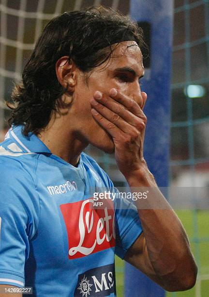 Napoli's forward Edinson Cavani reacts after Atalanta defeated Napoli at the end of the Italian Serie A football match between SSC Napoli and...