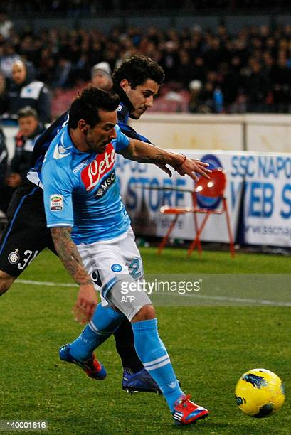Napoli's forward Ezequiel Lavezzi vies for the ball with Inter Milan's defender Marco Faraoni during the A Series football match between SSC Napoli...