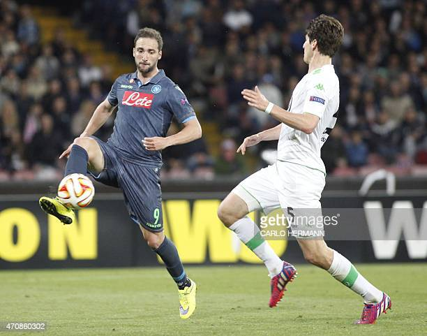 Napoli's forward from Argentina and France Gonzalo Higuain fights for the ball with Wolfsburg's defender from Switzerland Timm Klose during the UEFA...