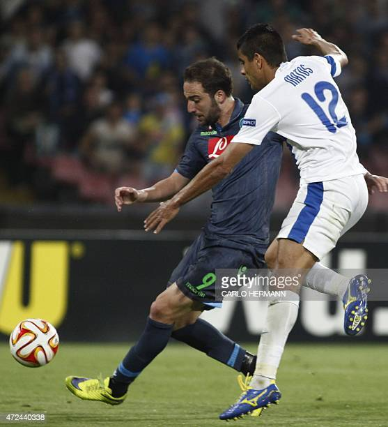 Napoli's forward from Argentina and France Gonzalo Higuain fights for the ball with Dnipro's midfielder from Brazil Leo Matos during the UEFA Europa...