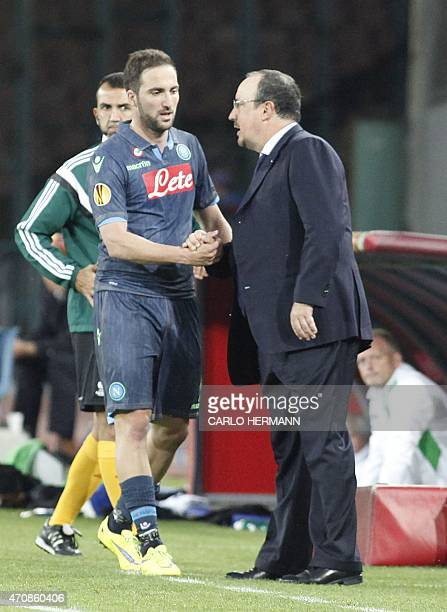 Napoli's forward from Argentina and France Gonzalo Higuain shake hands with Napoli's coach from Spain Rafael Benitez during the UEFA Europa League...