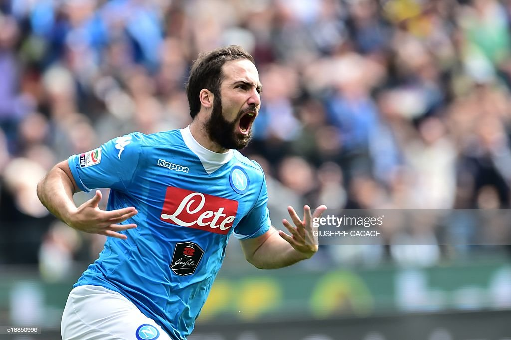 Napoli's forward from Argentina Gonzalo Higuain celebtrates after scoring during the Italian Serie A football match Udinese vs Napoli at Friuli Stadium in Udine on April 3, 2016. / AFP / GIUSEPPE