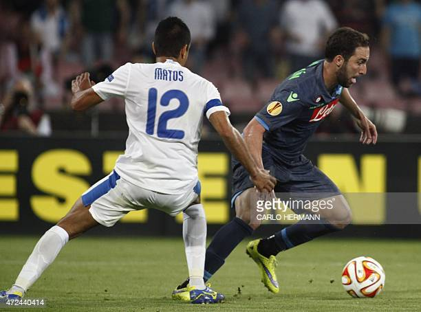Napoli's forward from Argentina Gonzalo Higuain fights for the ball with Dnipro's midfielder from Brazil Leo Matos during the UEFA Europa League semi...