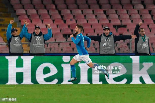 Napoli's forward from Belgium Dries Mertens celebrates after scoring during the UEFA Champions League Group F football match Napoli vs Shakhtar...