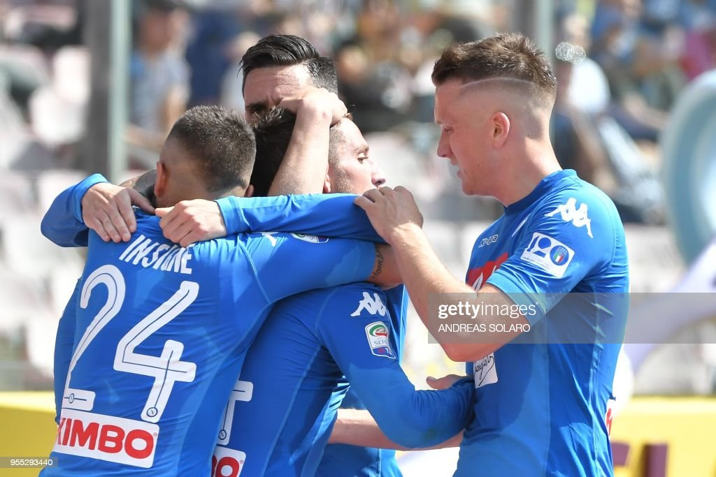Napoli's forward from Belgium Dries Mertens (C) celebrates with his teammates after scoring a goal during the Italian Seriea A football match between Napoli and Torino at the San Paolo Comunal Stadium in Naples, on May 6, 2018.