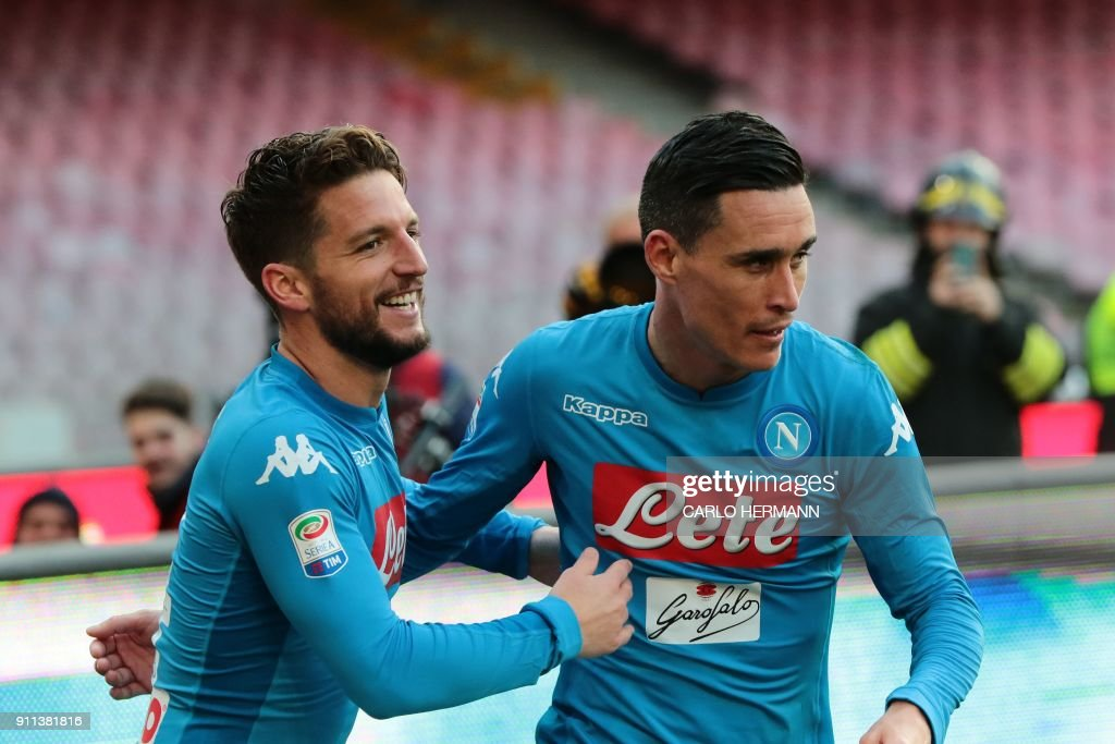 Napoli's forward from Belgium Dries Mertens (L) celebrates with teammate Napoli's midfielder from Spain Jose Maria Callejon after scoring during the Italian Serie A football match SSC Napoli vs Bologna FC on January 28, 2018 at the San Paolo Stadium. /