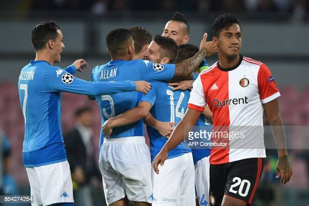 Napoli's forward from Belgium Dries Mertens celebrates with teammates after scoring next to Feyenoord's Peruvian midfielder Renato Tapia during the...