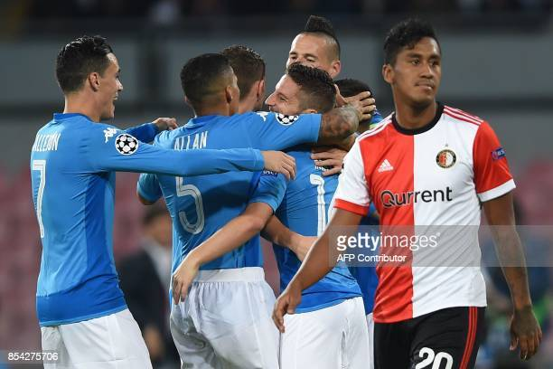 Napoli's forward from Belgium Dries Mertens celebrates with teammates after scoring during the UEFA Champion's League Group F football match Napoli...