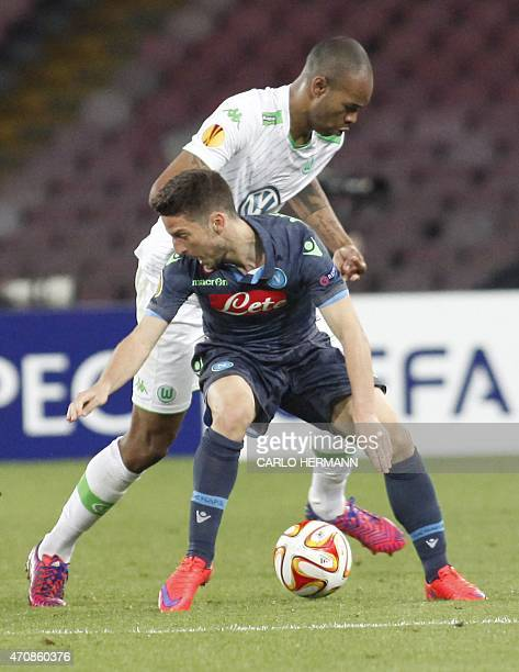 Napoli's forward from Belgium Dries Mertens fights for the ball with Wolfsburg's defender from Brazil Naldo during the UEFA Europa League quarter...