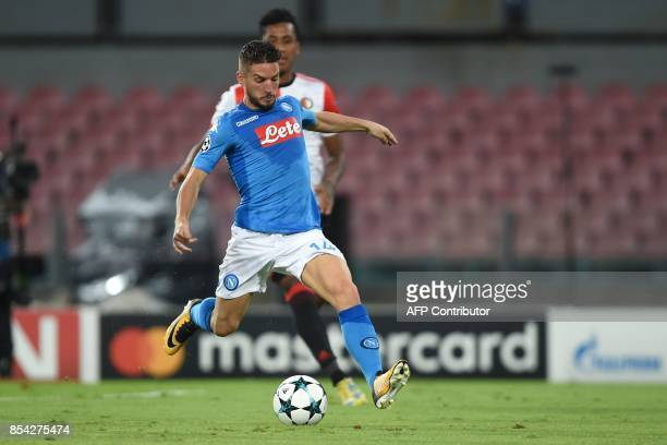Napoli's forward from Belgium Dries Mertens scores during the UEFA Champion's League Group F football match Napoli vs Feyenoord Rotterdam on...