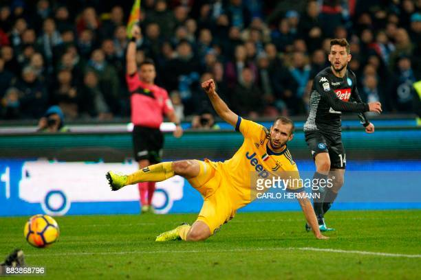 Napoli's forward from Belgium Dries Mertens vies with Juventus' defender from Italy Giorgio Chiellini during Italian Serie A football match Napoli vs...