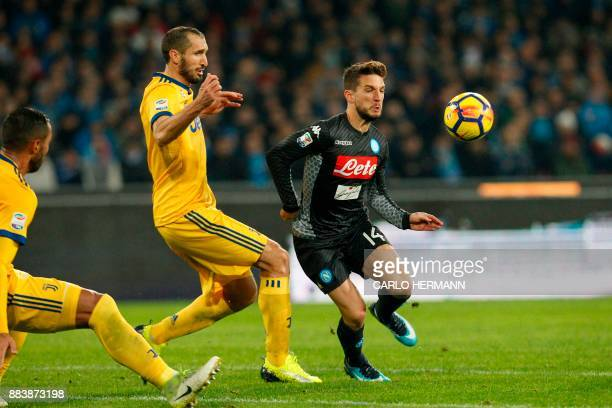 Napoli's forward from Belgium Dries Mertens vies with Juventus' defender from Italy Giorgio Chiellini during the Italian Serie A football match...